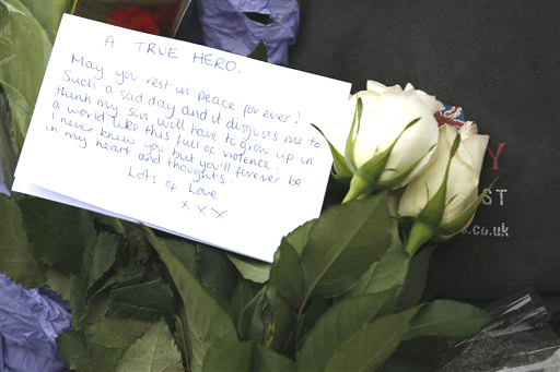 A floral tribute in memory of the victim is seen on Thursday outside the Royal Artillery Barracks near the scene of a terror attack in Woolwich, southeast London.