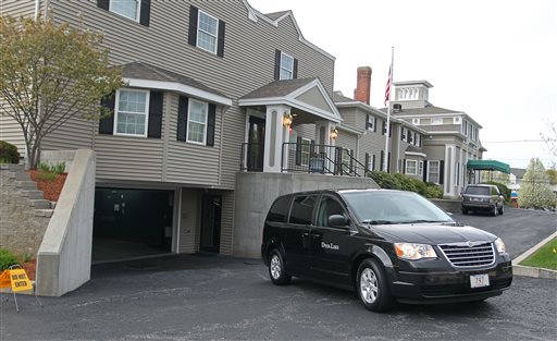 A vehicle believed to be carrying the body of Boston Marathon bombing suspect Tamerlan Tsarnaev backs into an underground garage at the Dyer-Lake Funeral Home in North Attleborough, Mass., on Thursday.