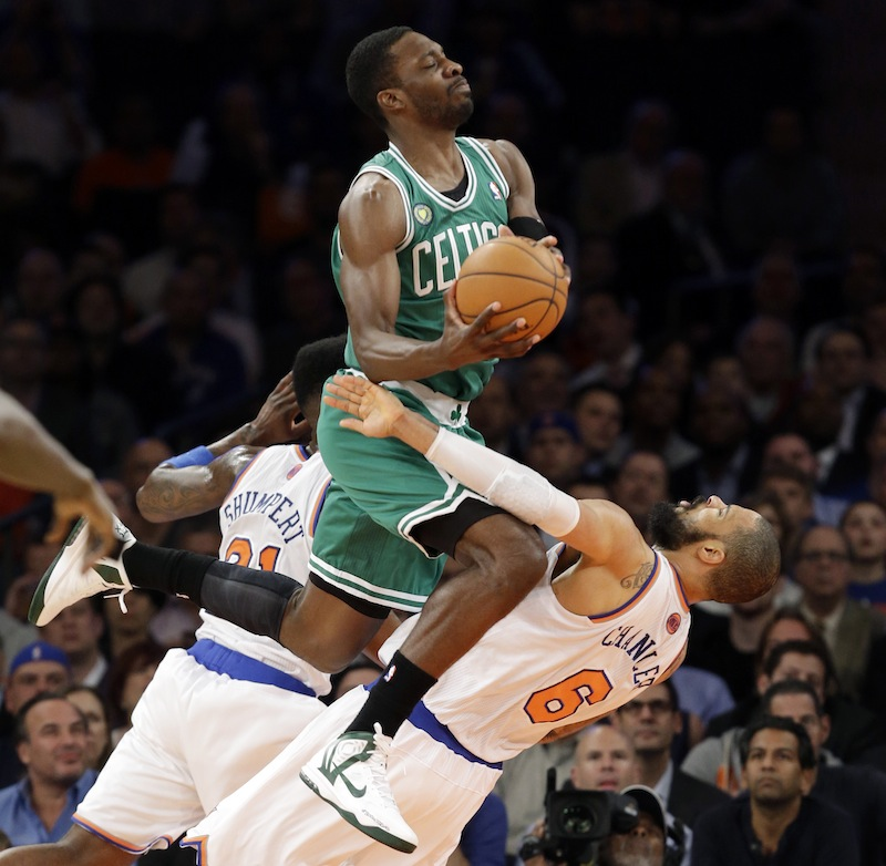 Boston Celtics forward Jeff Green (8) collides with New York Knicks center Tyson Chandler (6) in the first half of Game 5 of their first-round NBA basketball playoff series at Madison Square Garden in New York on Wednesday.