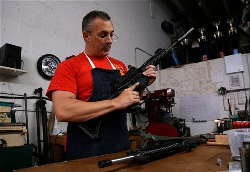 Jorge Corbato, 48, owner of Nebulous Ordnance, holds a M-16 rifle that he is servicing for a law enforcement official, Tuesday, April 9, 2013, in Miami. Corbato is a gun manufacturer who custom builds AR-15 rifles, services guns, and restores historic pieces for museums and collectors. Since the Sandy Hook school shootings in Newtown, Connecticut, Corbato says the supply for components needed to build the AR-15 has gone down, while prices have gone up. Lawmakers in Congress hope to gain a Senate floor vote on meaningful gun restrictions this week. (AP Photo/Lynne Sladky)
