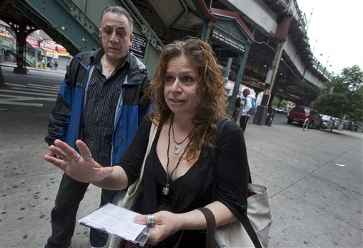 Folklorist Elena Martinez of City Lore, and her partner Bobby Sanabria, talk about their tours of The Bronx borough of New York on Wednesday.