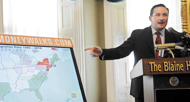 Missouri lobbyist Travis Brown presents demographic and income data from the Internal Revenue Service and U.S. Census Bureau on Monday at the Blaine House.