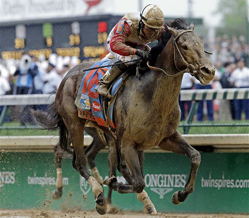 Joel Rosario spurs Orb, the 5-1 favorite, down the stretch Saturday to win the Kentucky Derby by 2 1⁄2 lengths for Shug McGaughey, the Hall of Fame trainer.