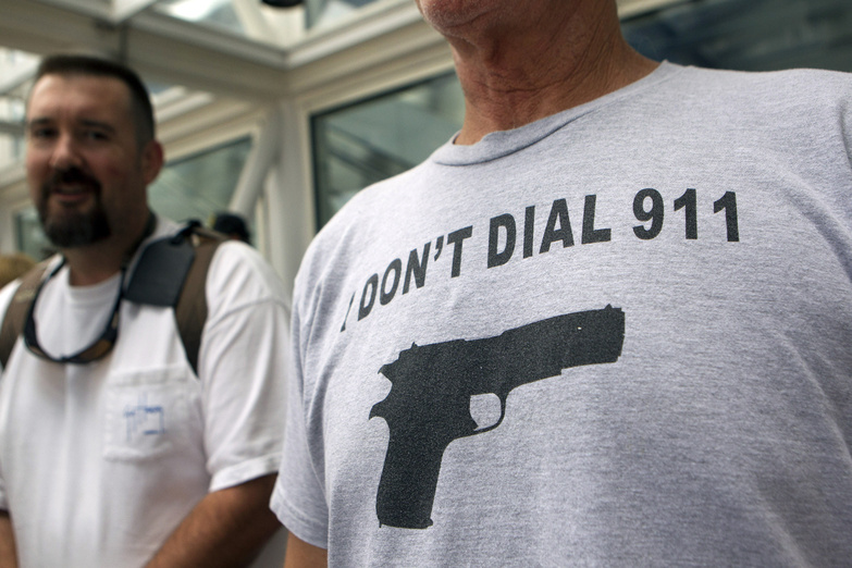 John Joseph of Sebastian, Fla., waits in line outside the George R. Brown Convention Center before the opening of the National Rifle Association's 142 annual meeting Thursday in Houston. NRA national Rifle Association set up 142 Annual Meetings and Ex