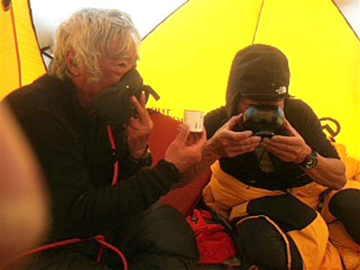 80-year-old Yuichiro Miura, left, uses an oxygen mask and his son, Gota, sips green tea as they take a rest at their camp at 26,247 feet before making the ascent to the summit of Mount Everest.