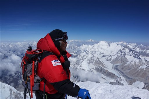 Yuichiro Miura, 80, who has had four heart operations in recent years, stands atop the summit of Mount Everest on Thursday.