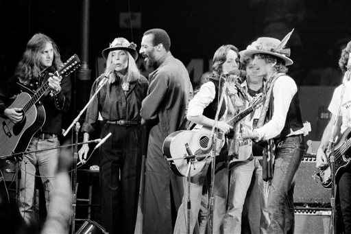 In this December 1975 photo, musicians Roger McGuinn, Joni Mitchell, Richie Havens, Joan Baez and Bob Dylan perform the finale of the The Rolling Thunder Revue, a tour headed by Dylan.