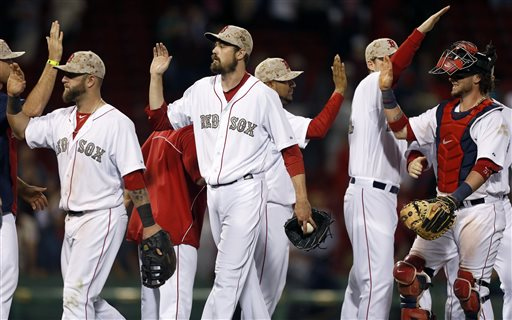 Boston Red Sox's Mike Napoli, left, Andrew Miller, center, and Jarrod Saltalamacchia, right, celebrate after defeating the Philadelphia Phillies 9-3 Monday in Boston.