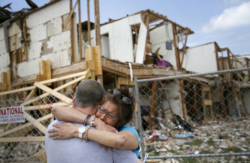 Shona Jupe, a resident of an apartment destroyed by the fertilizer plant explosion, hugs a friend while visiting the site in West, Texas, on May 10. Jupe was at the front door when the West Fertilizer Co. explosion happened.