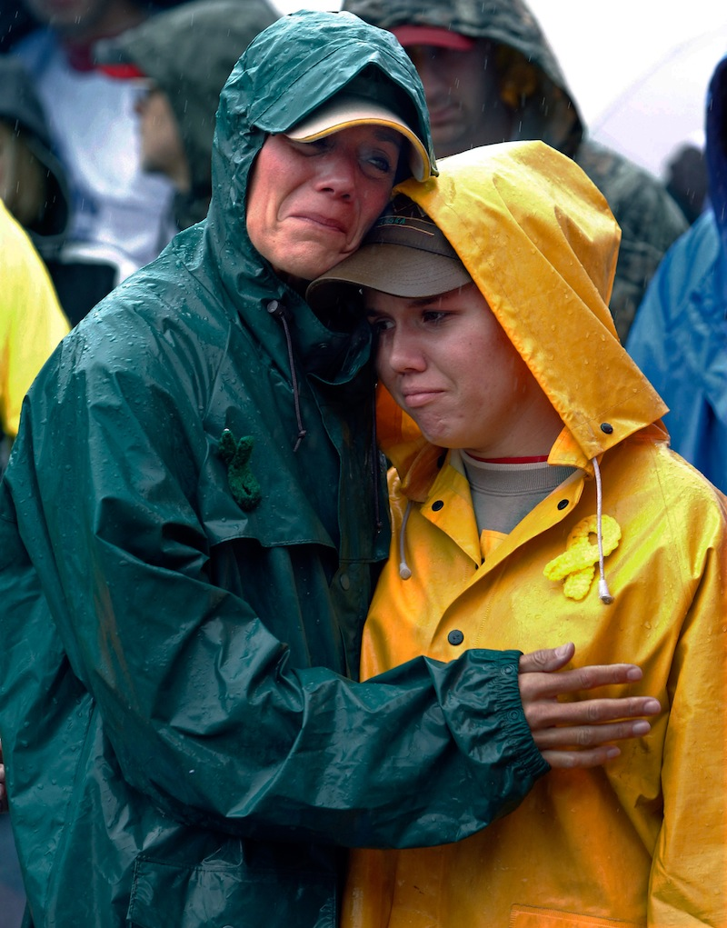 During a moment of silence, Joan Olsen, left, and her daughter Emily Olsen embrace at the start of the Walk for Suicide Awareness in Kaukauna, Wis. on Saturday, Sept. 11, 2010. Joan and Emily are honoring Chris Olsen, who is Joan's husband and Emily's father. The suicide rate among middle-aged Americans climbed a startling 28 percent in the decade between 1999 and 2010, the government reported Thursday, May 2, 2013, but the rates in younger and older people did not change. (AP Photo/Post-Crescent Media, Dan Powers)
