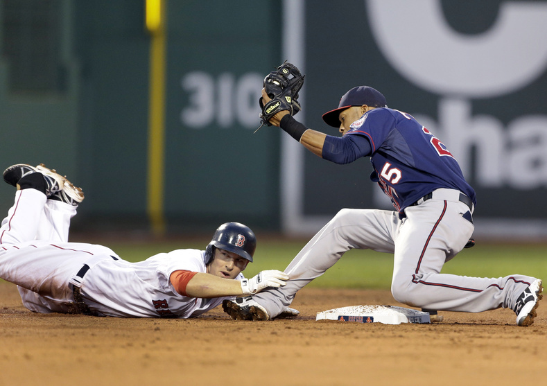 Boston's Stephen Drew is tagged out by Minnesota's shortstop Pedro Florimon trying to stretch a single into a double during the first inning at Fenway Park on Wednesday.