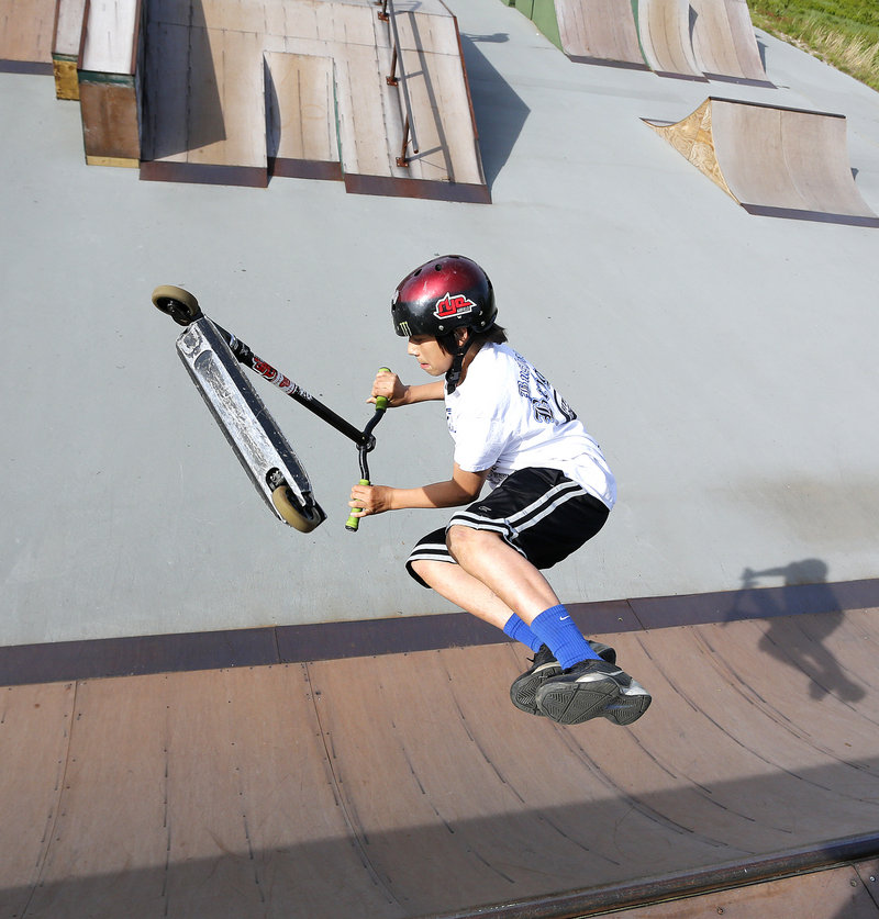 Alex Sappier, 13, of Windham flips his scooter while riding a ramp at Windham Skate Park on Tuesday, May 28, 2013. There will be no supervision at the park, starting July 1. The Town Council decided Tuesday to cut $17,000 to fund staffing at the park.