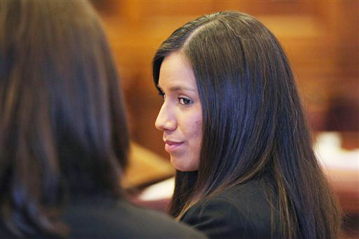 Alexis Wright, left, listens to her lawyer Sarah Churchill during a court hearing last year. She will be sentenced Friday.