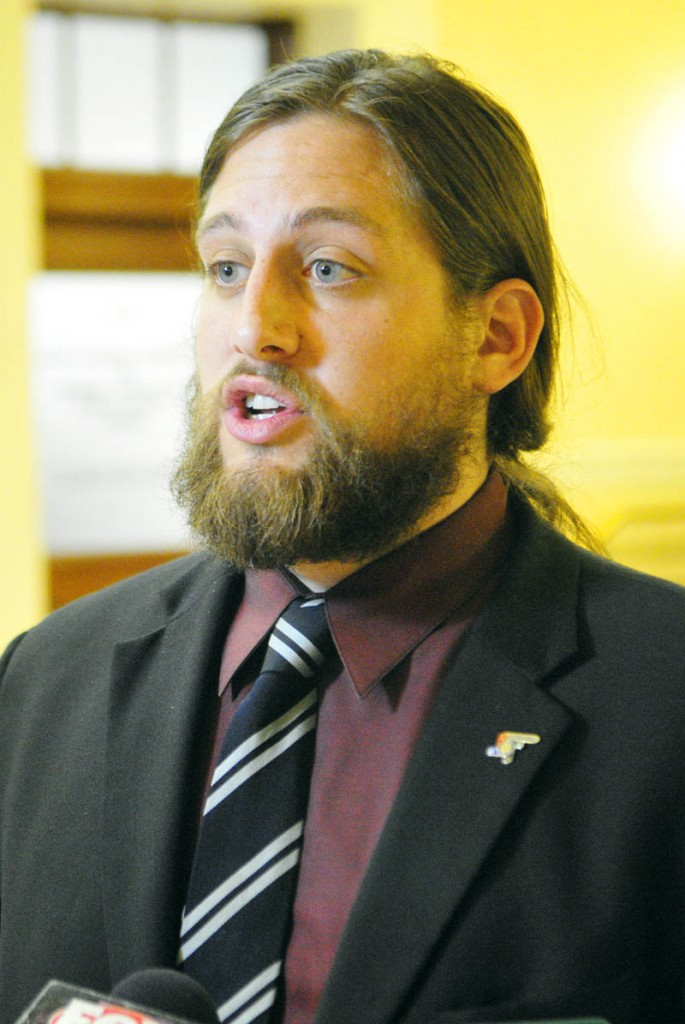 Paul T. McCarrier, legislative liason for the Medical Marijuana Caregivers of Maine, talks to reporters on Friday at the State House in Augusta. He was there to testify against LD 1229, An Act To Regulate and Tax Marijuana.