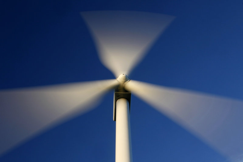 Blades rotate on a wind turbine on Maine's Stetson Mountain in this July 2009 file photo. The wind industry's grip on Augusta may be weakening. (AP Photo/Robert F. Bukaty)
