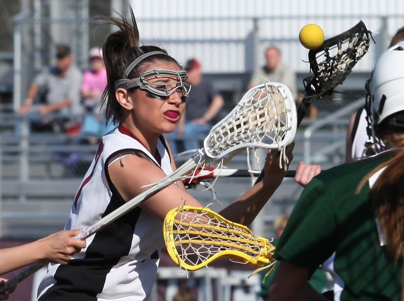 MacKenzie Collins of Gorham attempts to retain possession of the lacrosse ball while charging in for a shot against Bonny Eagle.
