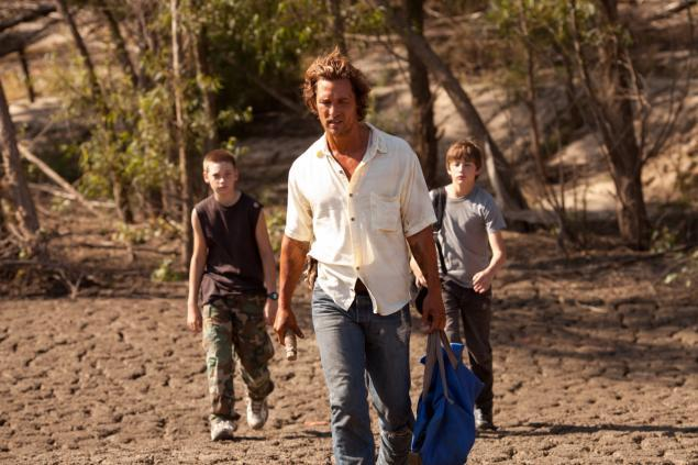 """Jacob Lofland, left, Matthew McConaughey and Tye Sheridan in """"Mud,"""" in which the boys help McConaughey's character, a fugitive, evade bounty hunters."""