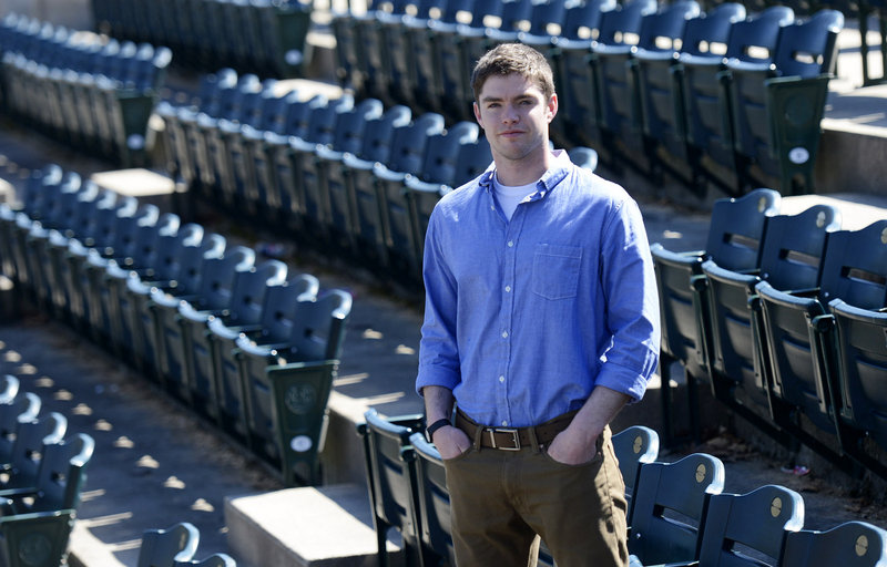 James Nutter, a former University of Southern Maine baseball player, revisits the USM baseball field in Gorham on Wednesday. He is now in demand as a speaker about the gay experience in team sports.