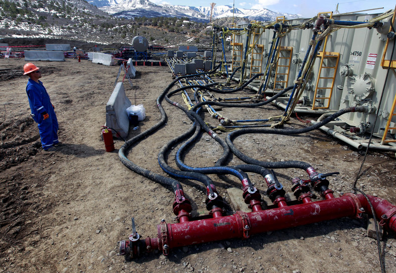 A worker monitors water pumping pressure and temperature at a hydraulic fracturing and extraction site in western Colorado. Hydraulic fracturing is the practice of injecting water, sand and chemicals to help access oil and gas deposits.