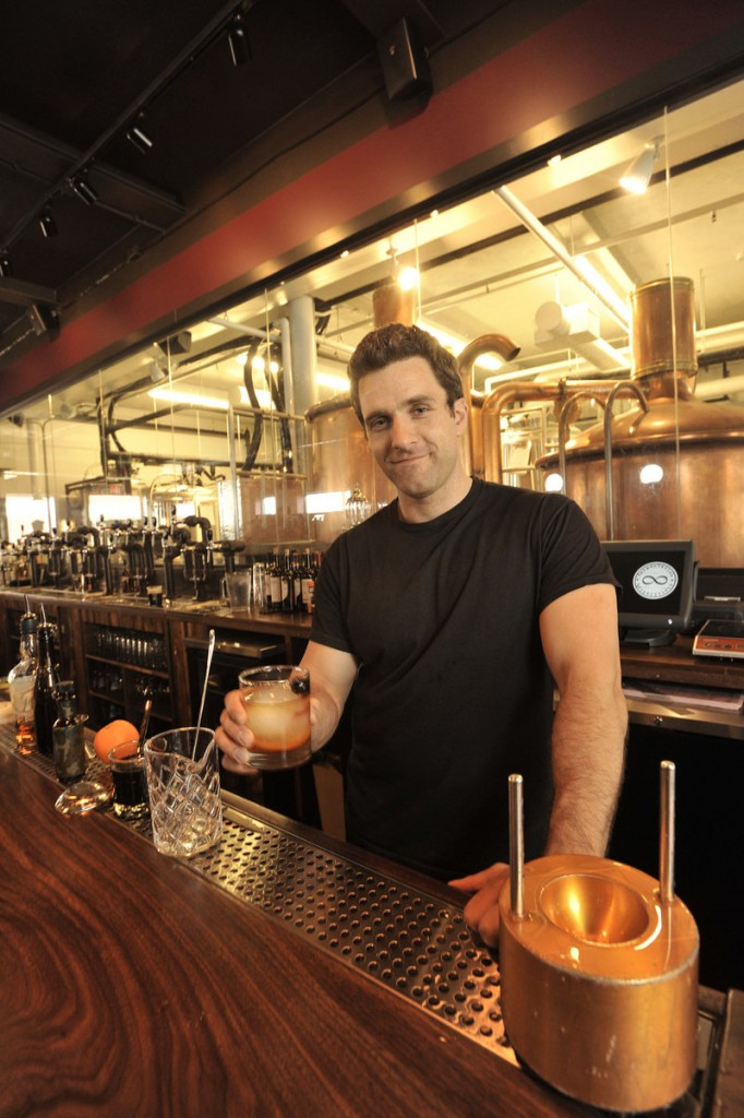 Dave Thompson, a bartender at In'finiti Fermentation & Distillation, prepares a Haute Fashioned, the bar's variation on a traditional Old Fashioned.