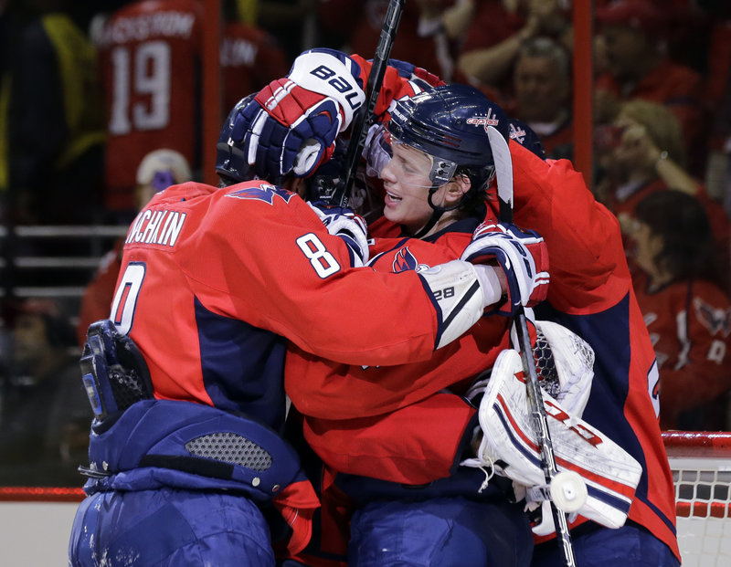 How sweet it is for the Washington Capitals as they celebrate a goal during their 3-1 victory over the New York Rangers in Game 1 of the first-round series.