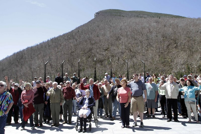 Hundreds of people gather at a park below where the Old Man of the Mountain was once seen, Friday, May 3, 2013 in Franconia, N.H. during a ceremony for the 10th anniversary of the date the natural rock formation and state emblem crashed to the ground. (AP Photo/Jim Cole)
