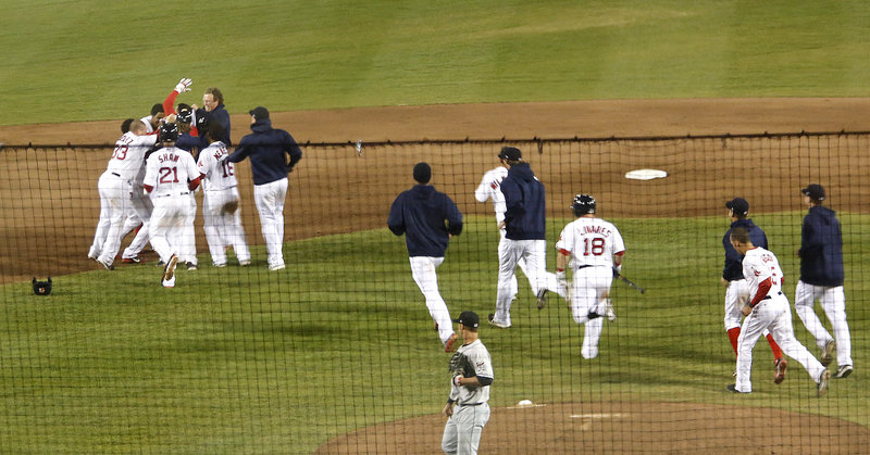 The Portland Sea Dogs celebrate a 5-4 win over the New Britain Rock Cats, congratulating Xander Bogaerts after his shallow fly to center was dropped for an error, allowing two runs to score in the ninth inning at Hadlock on Friday.
