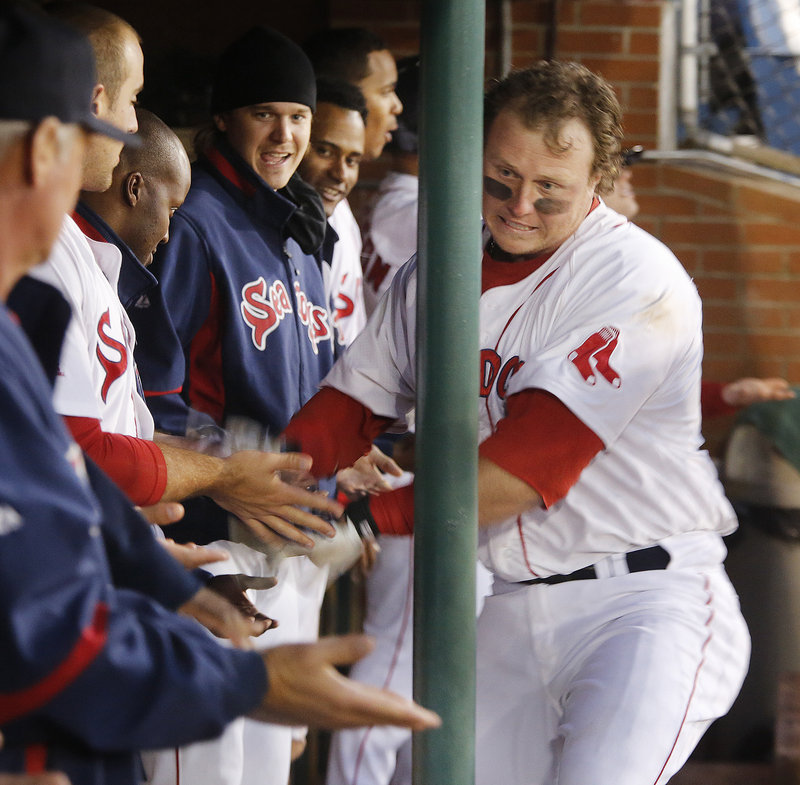 Portland's Matt Spring gets the glad hands in the dugout after hitting a two-run homer in the seventh inning during the Sea Dogs' 5-4 win over New Britain at Hadlock on Friday.