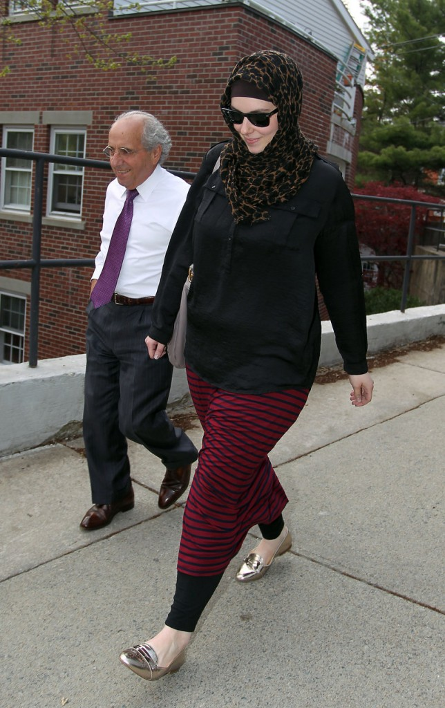 Katherine Russell, widow of Boston Marathon bomber  Tamerlan Tsarnaev, leaves the law office of DeLuca and Weizenbaum with Amato DeLuca, in Providence, R.I., in this April 29, 2013, photo. The Associated Press