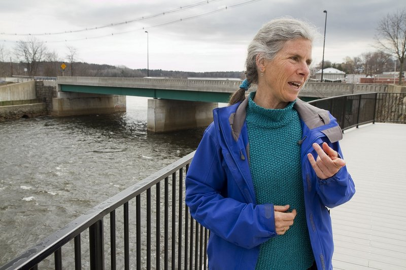 RiverWalk Coalition Director Alix Hopkins talks about her organization's plans while standing on a scenic overlook that gives views of the Saco River on the Biddeford side.