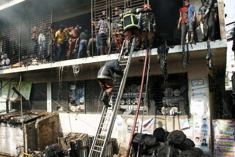 Firefighters try to douse a garment factory fire in Dhaka, Bangladesh, last year. After a series of fatal incidents in the industry there, experts say businesses that sell clothing need to help eliminate work hazards to protect their images.