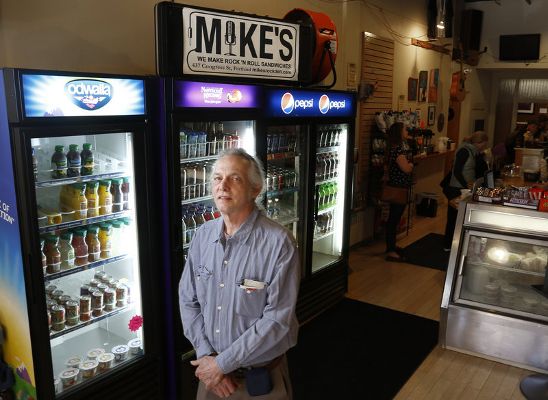 """Mike Fink, owner of Mike's Restaurant and also Guitar Grave on Portland's Congress Street, says he has been """"aggravated"""" by protest activity, which he believes adversely affects his nearby businesses."""