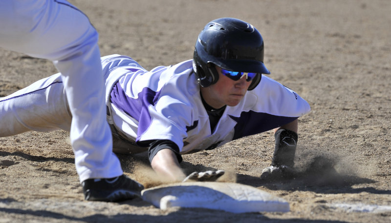 Nick Bevilacqua of Deering makes it back to first base as Biddeford attempts to pick him off. Bevilacqua later singled during a two-run seventh inning that tied the game before Biddeford won it.