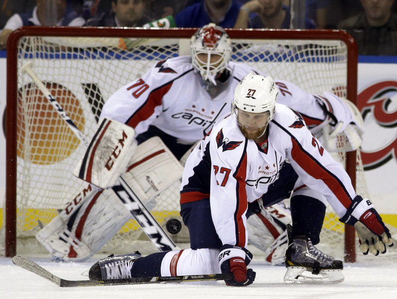 Washington defenseman Karl Alzner blocks a shot in front of goaltender Braden Holtby during first-period action of Wednesday's playoff game in New York, won by the Rangers.