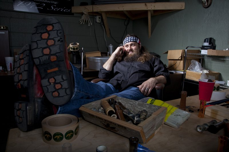"""Willie Robertson, star of A&E's """"Duck Dynasty,"""" relaxes at the Duck Commander warehouse in West Monroe, La. Cameras follow Robertson and his family as they make duck calls, hunt or go camping."""
