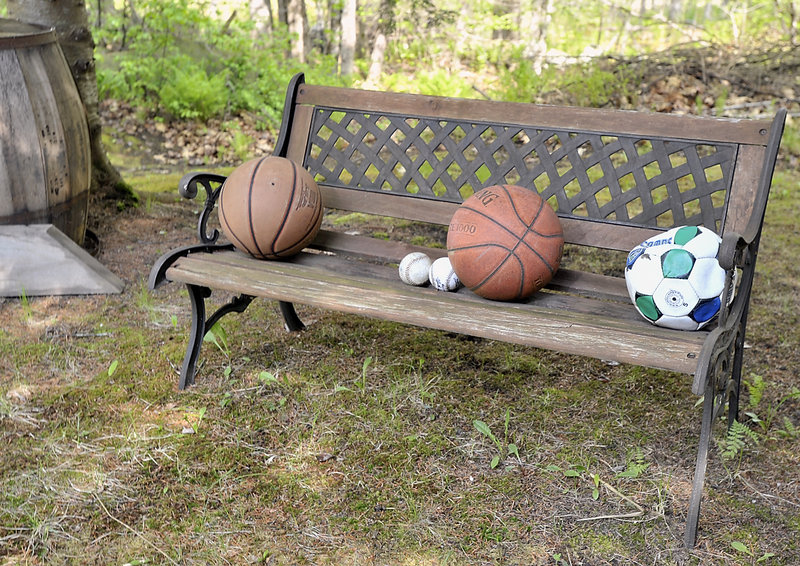 "Sports balls are laid upon a bench in the garden made by Ramona Torres of Denmark, dedicated to her son Angel ""Tony"" Torres, who disappeared 14 years ago."