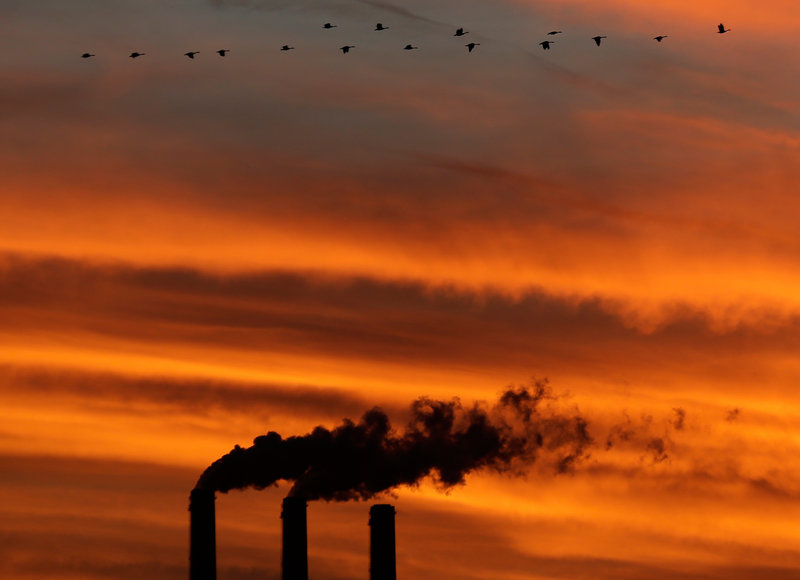 Geese share the atmosphere with emissions from the smokestacks at the Jeffrey Energy Center coal power plant as the sun sets near Emmett, Kan. With carbon dioxide now measuring at 400 parts per million, the greenhouse gas has reached a level that probably has not been reached for at least 2 million years.