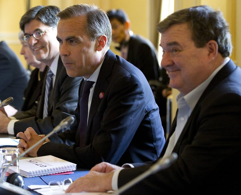 Mark Carney, governor of the Bank of Canada, is flanked by U.S. Treasury Secretary Jacob Lew, left, and Canadian Finance Minister Jim Flaherty at the start of the G7 finance ministers and central bank governors meeting.
