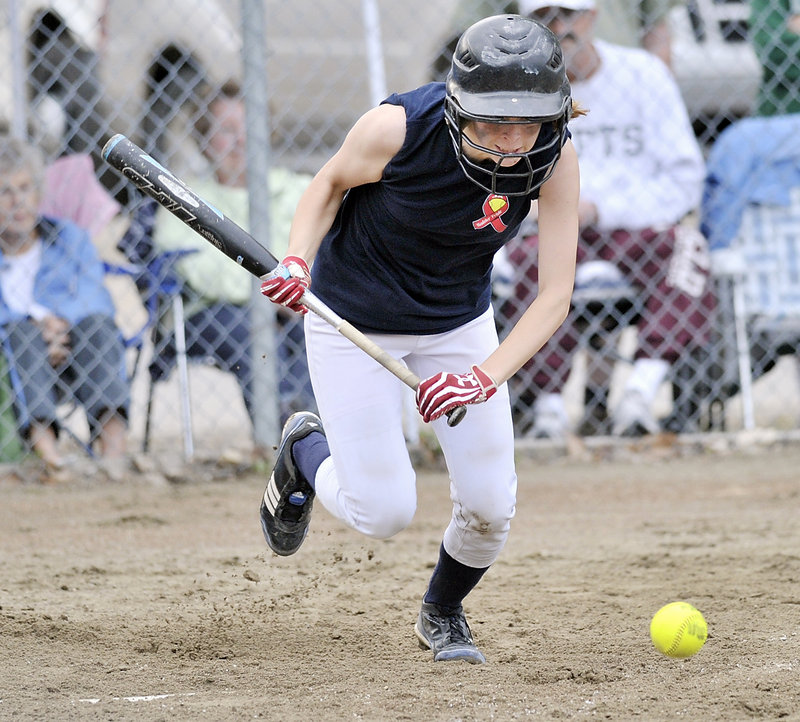 Maddie Foster lays down a bunt and begins her charge to first base against Cape Elizabeth. Foster was safe on the play.