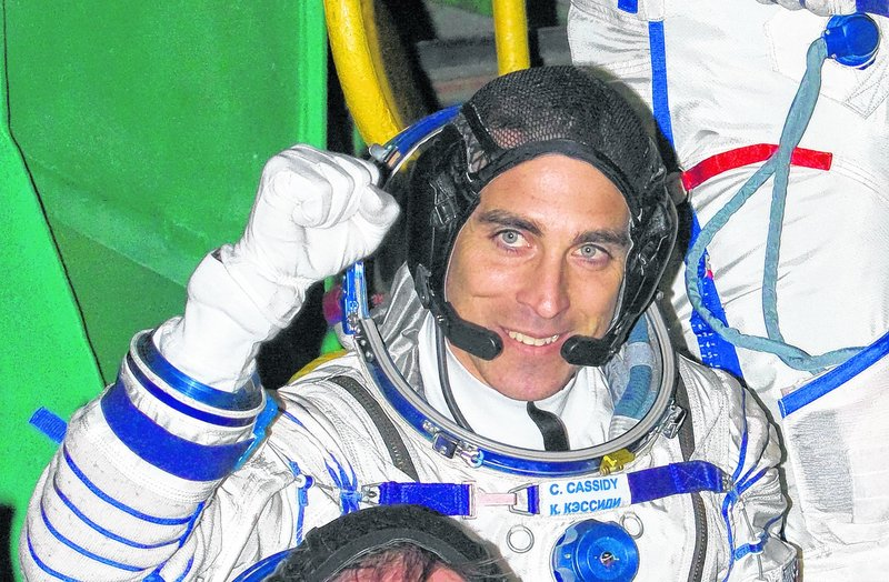 Christopher Cassidy, who grew up in York, pumps his fist before taking off for the International Space Station March 28. Cassidy was part of a hastily planned spacewalk Saturday that repaired a serious ammonia leak on the station.