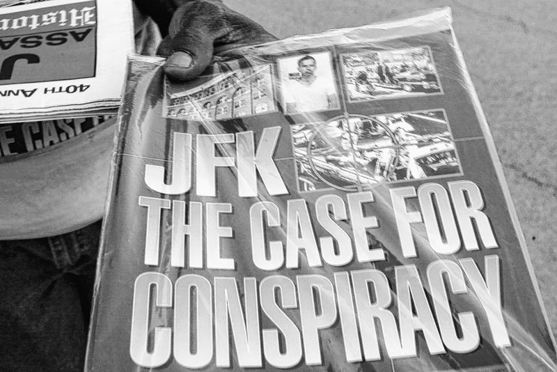"A vendor holds a publication titled ""JFK The Case For Conspiracy"" in Dallas in 2003."