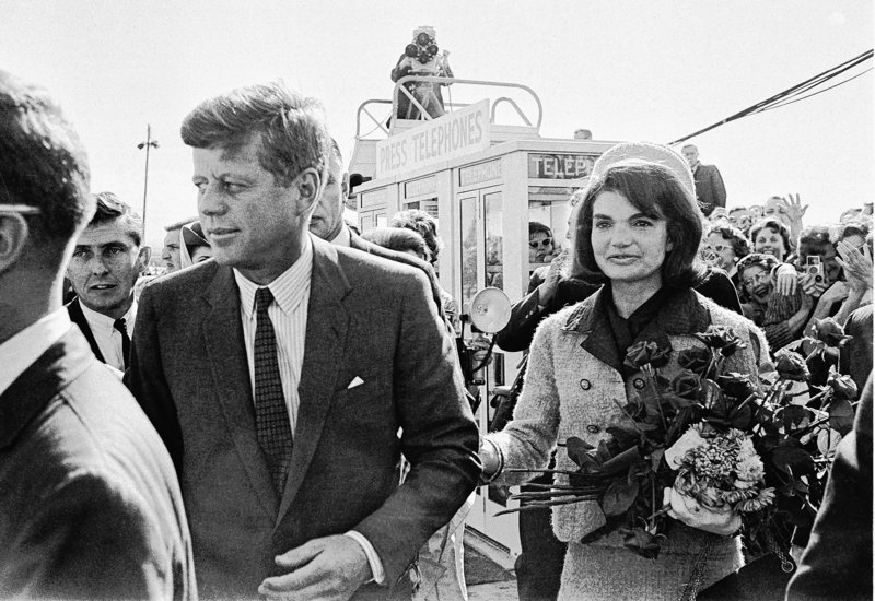 President John F. Kennedy and his wife, Jacqueline Kennedy, arrive at the airport in Dallas on Nov. 22, 1963, shortly before JFK was assassinated. PBS says its fall schedule will include a variety of specials marking President Kennedy's death 50 years ago.