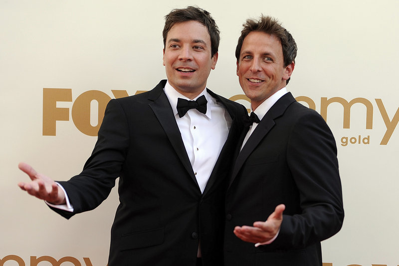 """Seth Meyers, right, will replace Jimmy Fallon, left, when Fallon replaces Jay Leno on """"Tonight"""" next year."""