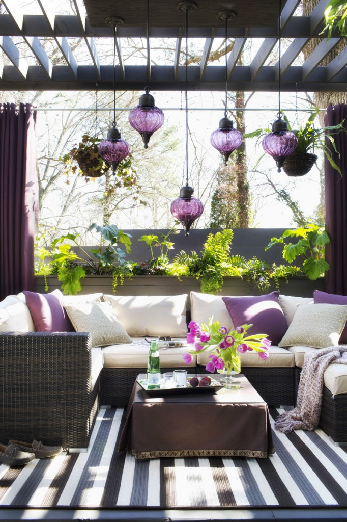 Designer Brian Patrick Flynn turned a narrow 14- by 9-foot outdoor space into a full-fledged living room by adding a pergola for shade and suspending outdoor pendant lights. A planter wall provides privacy and a braided indoor-outdoor area rug creates an indoor feeling.