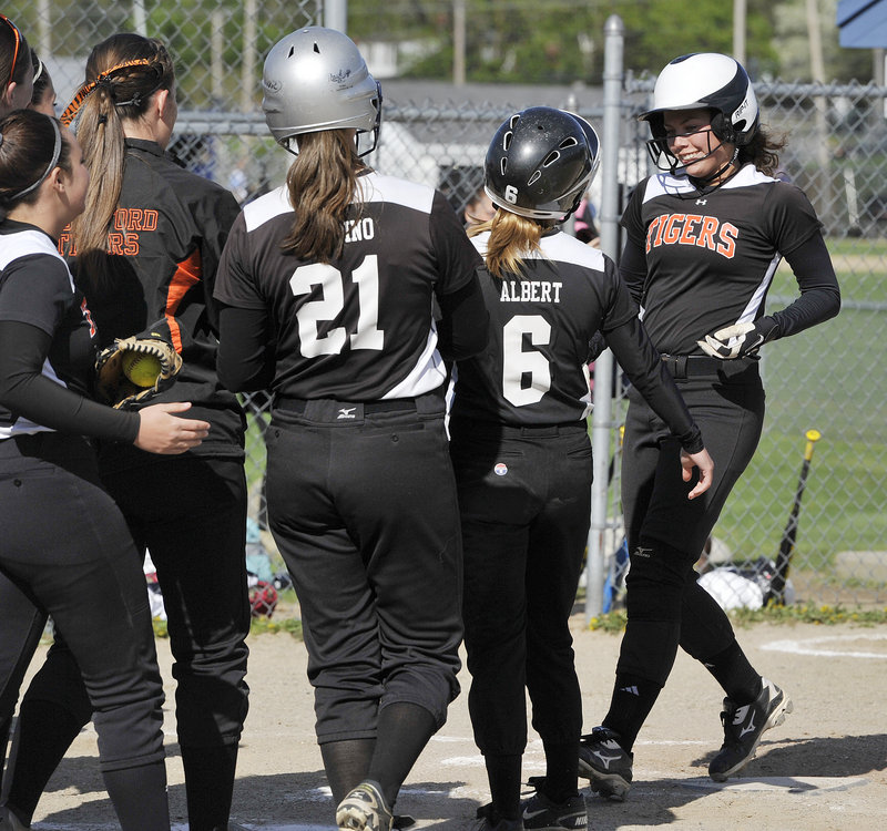 Biddeford's Katelyn Lebreux, a senior captain, is greeted at the plate after her two-run homer in the second inning during a 7-1 win at Westbrook on Monday.