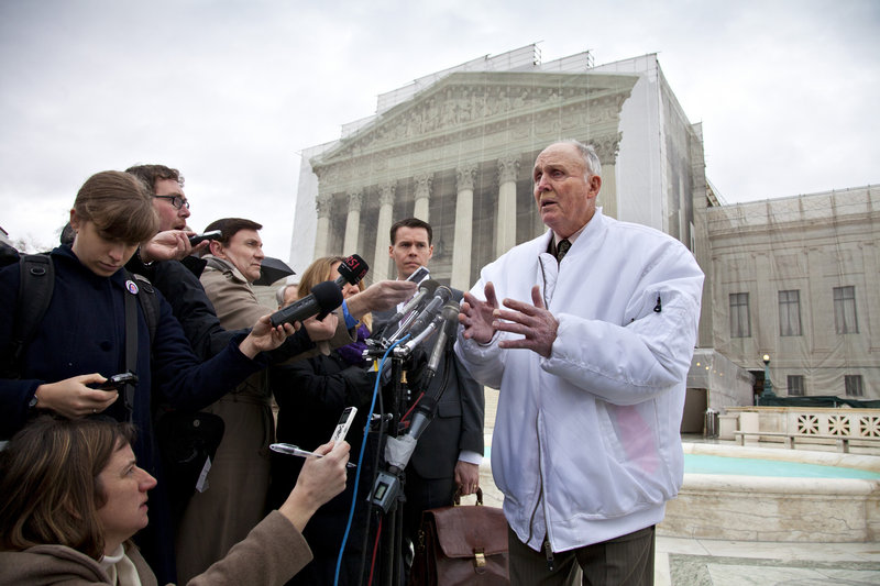 In this Tuesday, Feb. 19, 2013, photo, Vernon Hugh Bowman, a 75-year-old Indiana soybean farmer, speaks with reporters outside the Supreme Court in Washington. Supreme Court said Monday, May 13, 2013, that an Indiana farmer violated Monsanto Co.'s patents on soybean seeds resistant to its weed-killer. The farmer had been growing the beans without buying new seeds from the corporation. (AP Photo/J. Scott Applewhite)