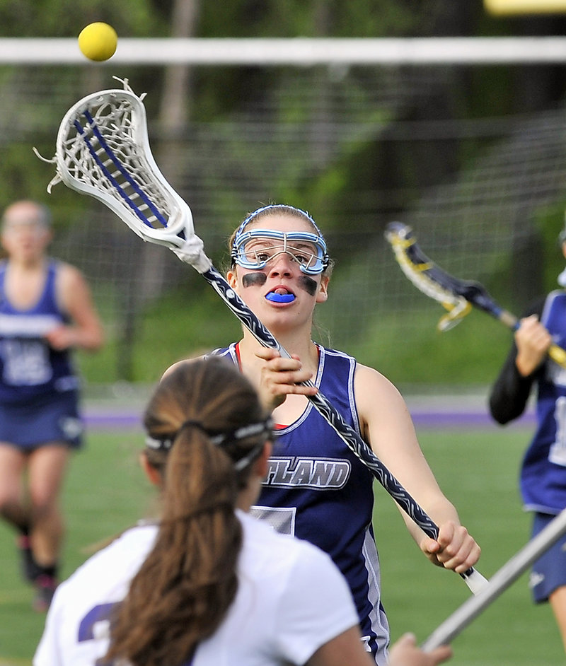 Lizzie Landry of Portland whips a pass over the head of a Deering defender. Portland improved to 6-2.