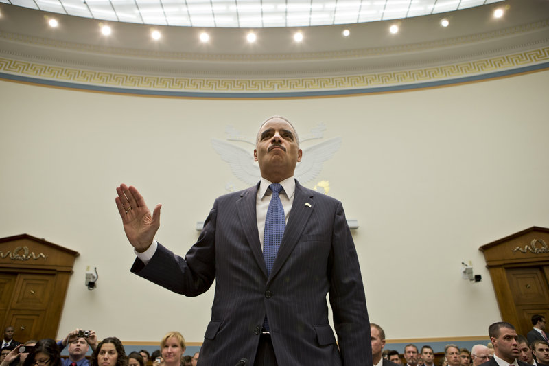Attorney General Eric Holder, the nation's top law enforcement official, is sworn in Wednesday before testifying at a House Judiciary Committee oversight hearing.