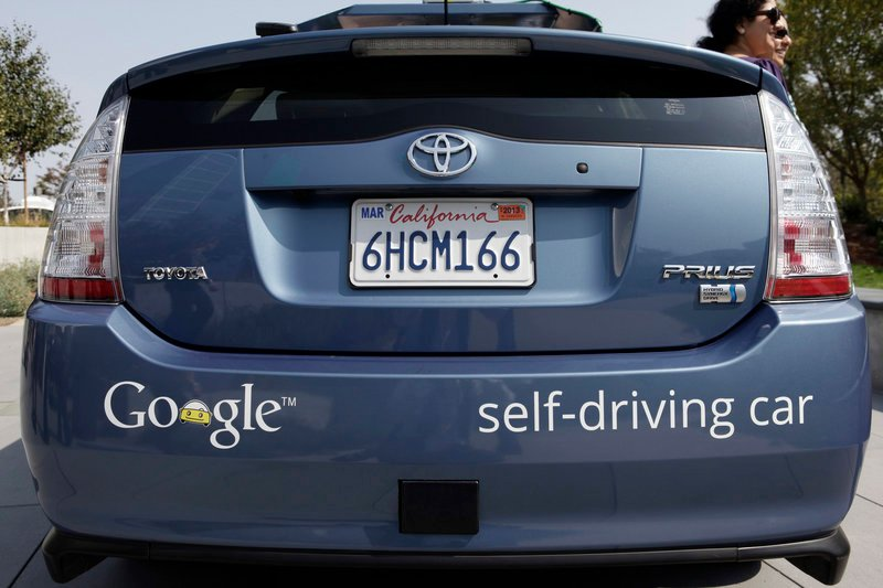 A driverless car is displayed at Google headquarters in Mountain View, Calif. Fully autonomous models are less than a decade from dealerships, and someday we could be debating whether people should be allowed to drive at all.