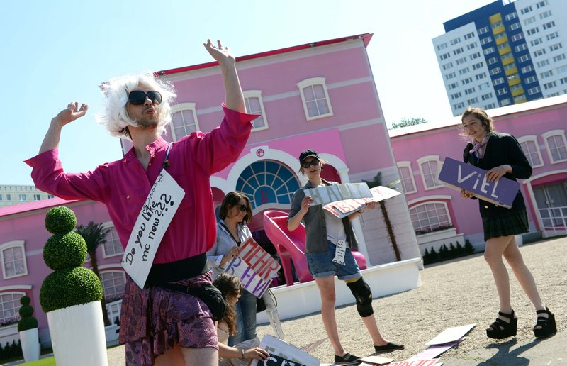 """Demonstrators protest in front of the """"Barbie Dreamhouse"""" in Berlin on Thursday. The theme house in Berlin is the second after a similar one opened recently in Florida."""
